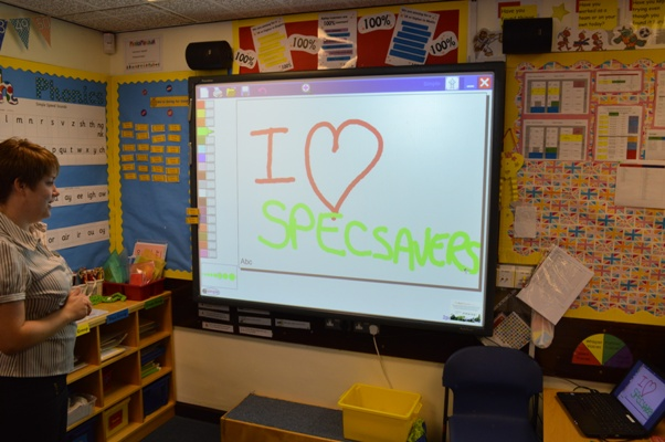 Opticians from Telford Specsavers teaching pupils the importance of eye health