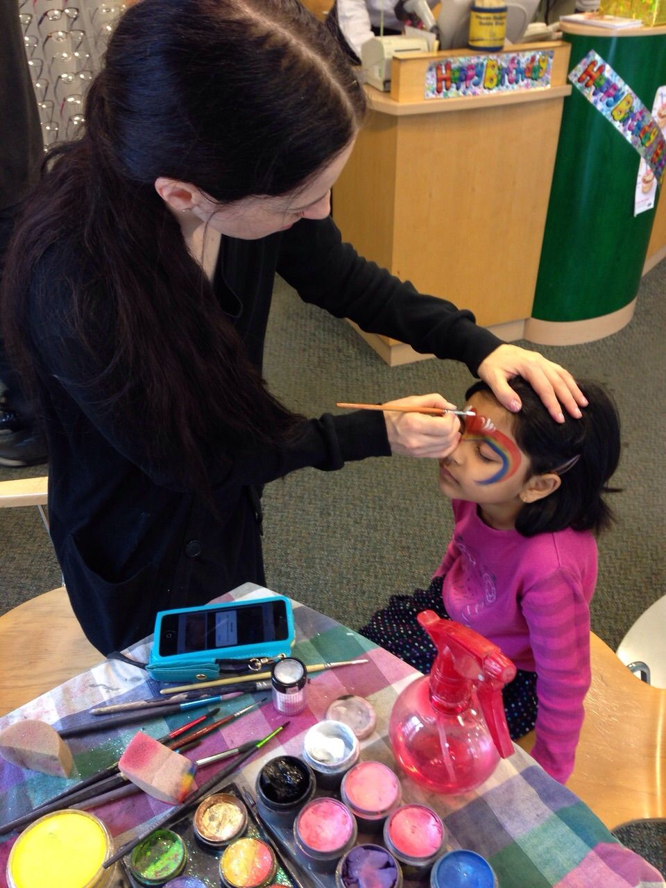 Bethnal Green Specsavers store birthday with face painter