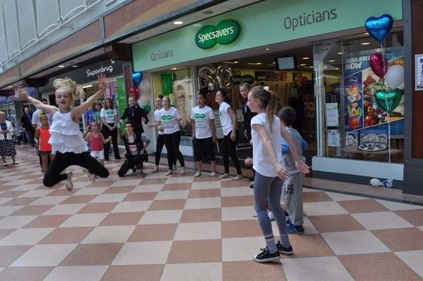 The flash mob outside the store in action