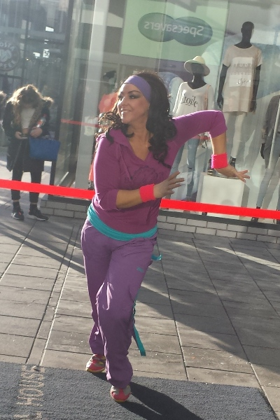 Hayley-Jo Witney, the short-sighted fitness instructor from Specsavers' national TV campaign, performing for New Square shoppers in West Bromwich