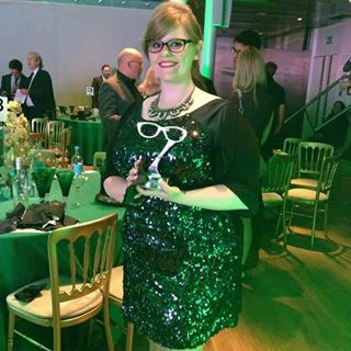 Kirsty Bilbie at the Spectacle Wearers of the Year competition picking up her Facebook winner trophy