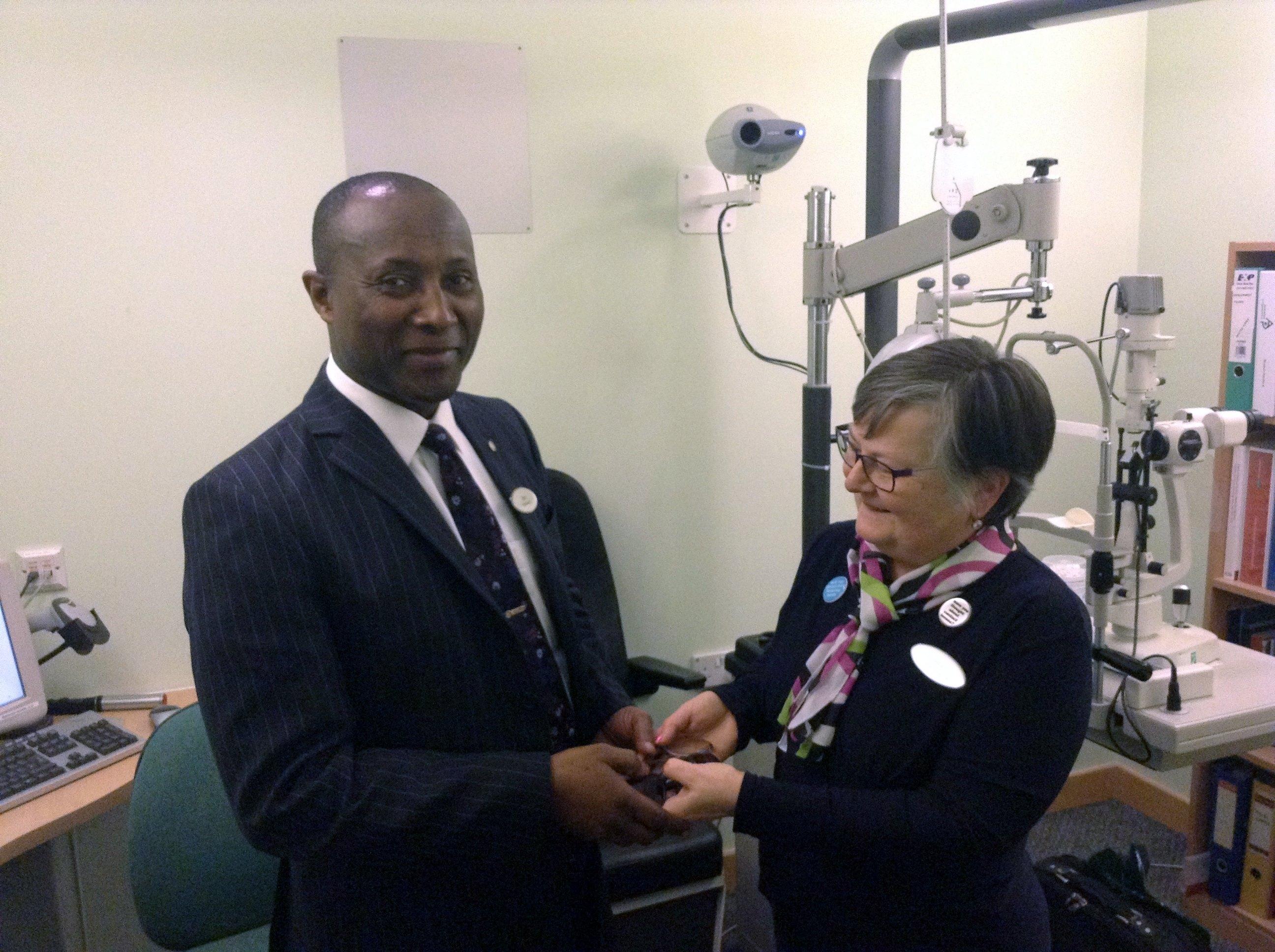 Sam Ekuful with Specsavers Ashford staff member, Rita Kegos