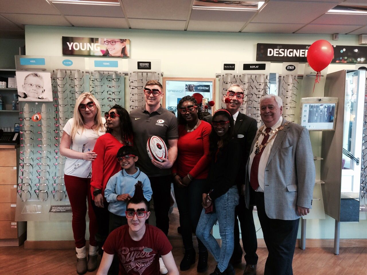 The Specsavers St Albans team with the Mayor and Chris Ashton