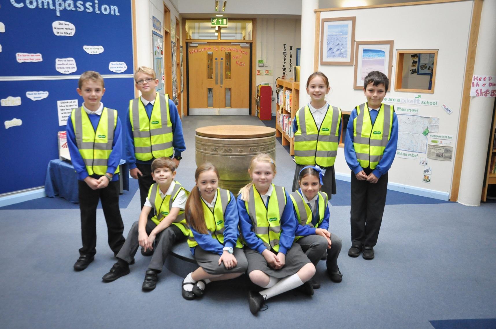 Children at St Botolphs don their new hi-vis vests