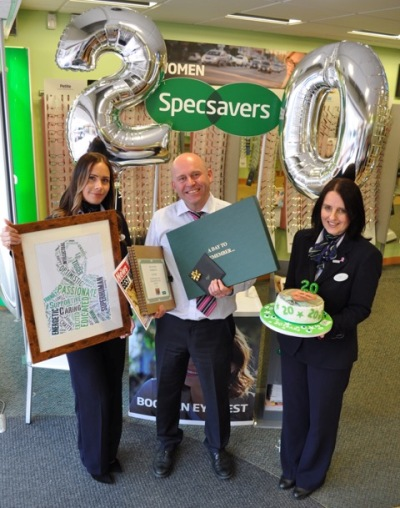 Store director Nigel receiving his presents for celebrating 20 years at the store