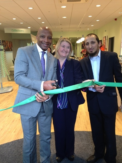 Cyrille Regis cutting the ribbon at the new Specsavers store at the New Square shopping complex, with store directors, Michelle Powell and Majid Jawaid