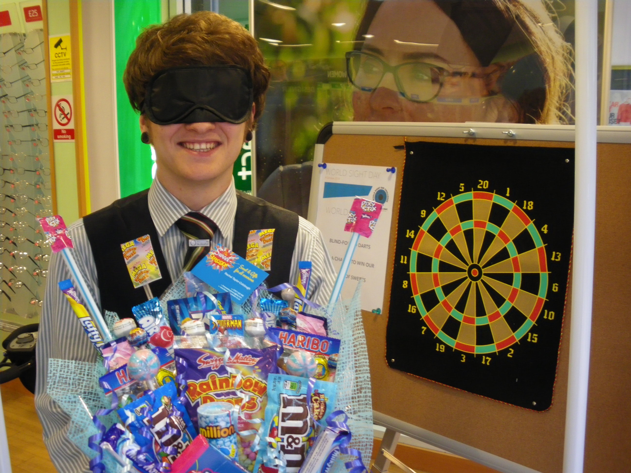 Tom Best from the team at Specsavers in Sutton in Ashfield with the sweet hamper